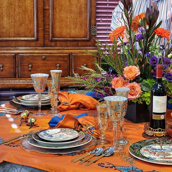 HEMSTITCHED BLUE DINNER NAPKIN ON EXOTIC SUNSET TABLETOP