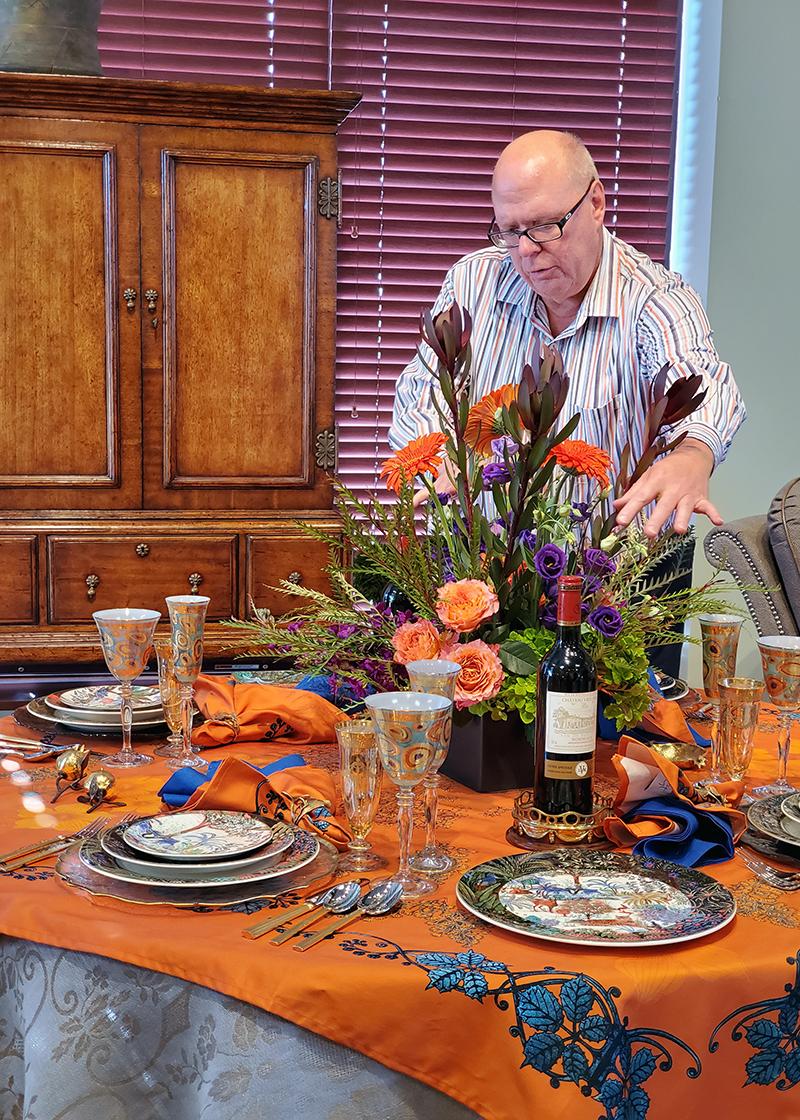 Daniel Vaughn with flower arrangement