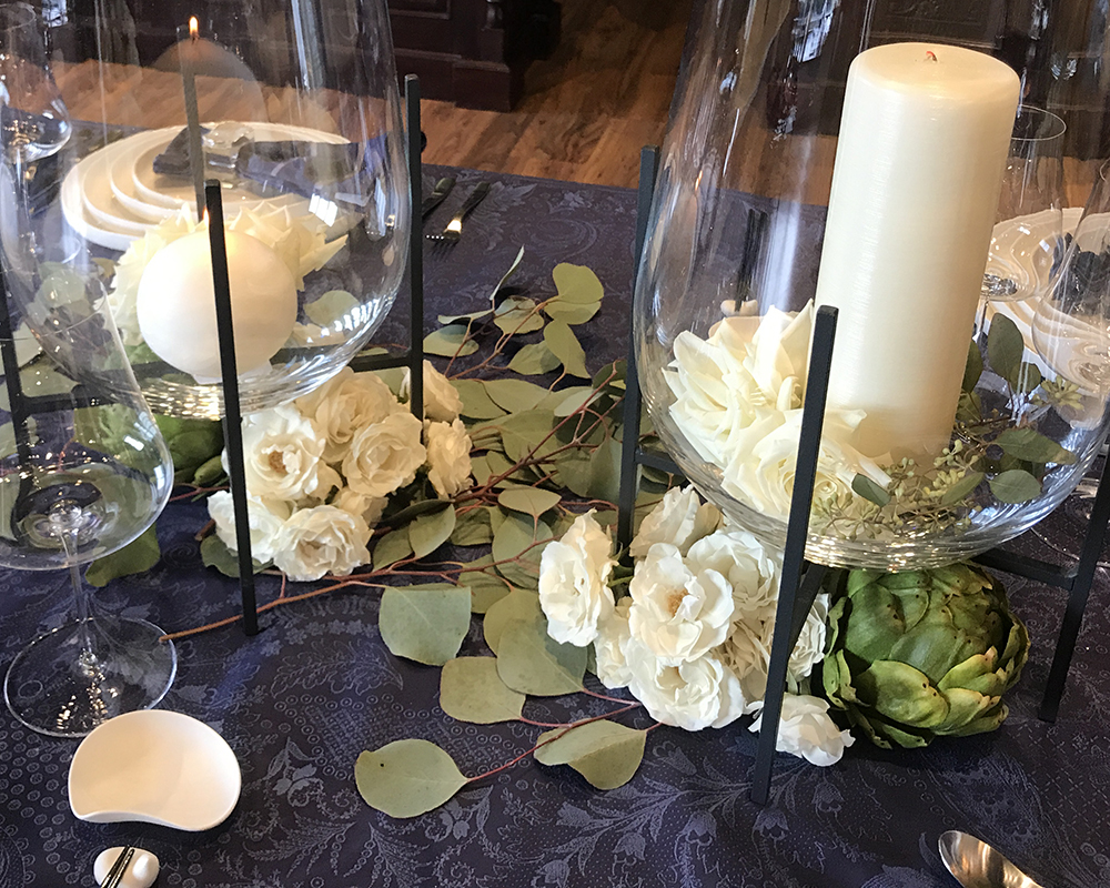 White candles on blue tabletop