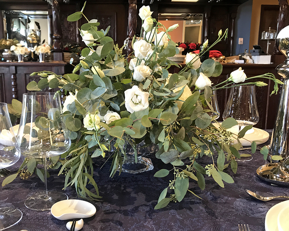 Flowing green and white flower arrangement